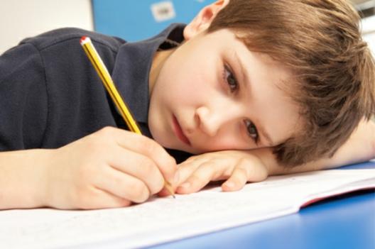 Boy head on desk 2